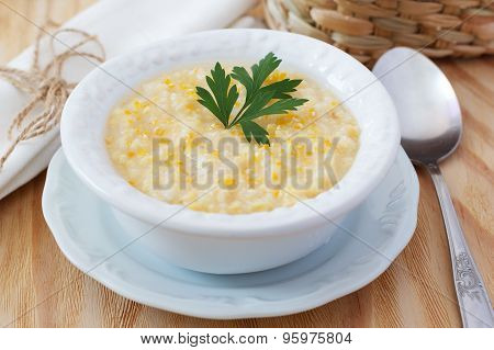 Brazilian corn soup canjiquinha in white vintage plate