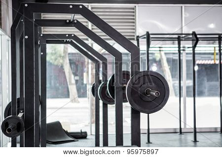 Side view of barbells in crossfit gym