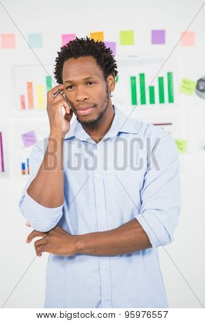 A thinking Young Businessman at the office