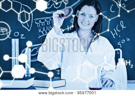 Science graphic against beautiful scientist showing a petri dish