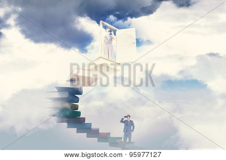 Businessman using binoculars against bright blue sky with clouds