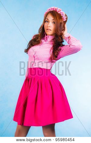 Cute Young Woman In A Pink Clothes