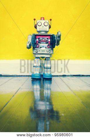 retro  robot toy on a wooden floor