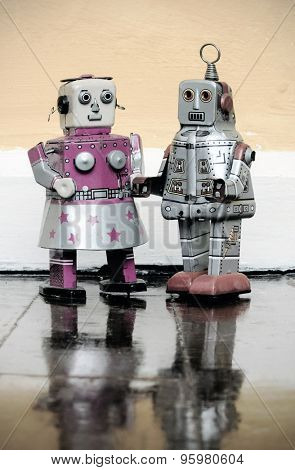 robots in love on wooden floor