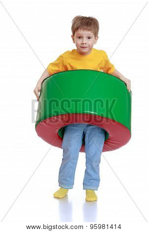 Cheerful little boy in a yellow t-shirt
