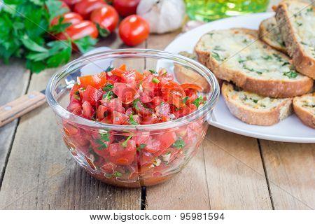 Making Tomato Bruschetta: Garlic Cheese Crostini And Chopped Tomatoes With Herbs