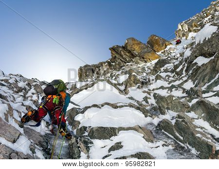 climbers at the mountain summit in scenic Tian Shan range in Kyrgyzstan, Ala-Archa national park