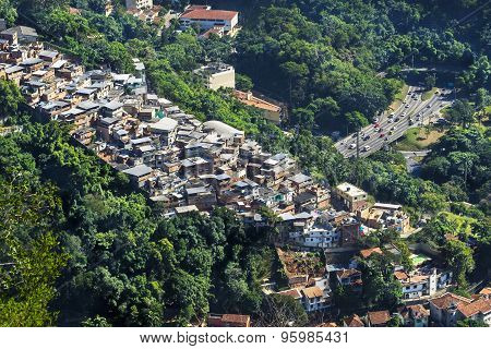 Aerial View of Traffic Next To Favela (Shanty Town) In Rio De Janeiro, Brazil