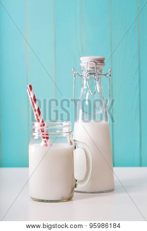 Milk In Mason Jar With Red Striped Straws