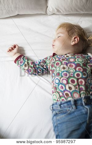Colored Shirt Baby Sleeping On White Bed