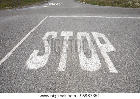 Crossroads With Stop Signal Painted On Asphalt