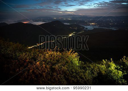 Night valley with illuminated villages. View from Adam's Peak, Sri Lanka