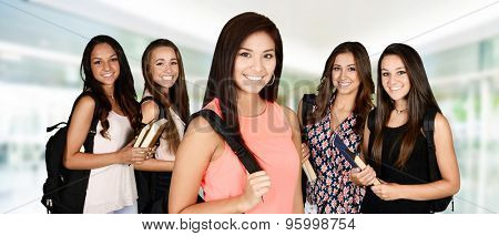 Students going to class at their college