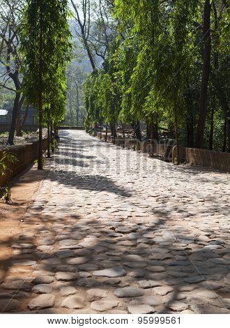 Road paved stone blocks. India Goa
