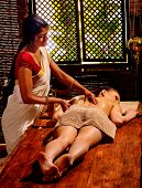image of panchakarma  - Young white woman having oil Indian spa treatment - JPG