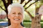 pic of 55-60 years old  - head shot of a beautiful 55 to 60 year old caucasian woman in an outdoor setting - JPG