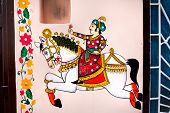 stock photo of rajasthani  - Traditional Rajasthan painting on the house wall of king riding on the horse in Udaipur Rajasthan India - JPG