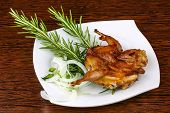 image of quail  - Grilled quail with rosemary on the wood background  - JPG