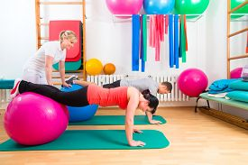 stock photo of therapist  - Patients at the physiotherapy doing physical exercises with therapist - JPG