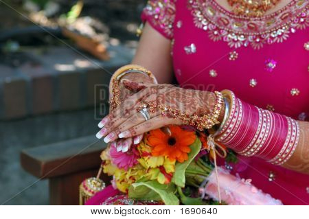 Hands Of A Indian Bride With Henna Design And Bangles