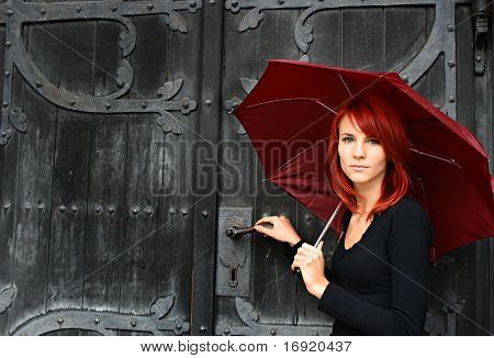 beautiful girl under rad umbrella