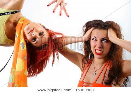 two funny bright girls jerking in studio