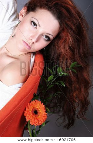 beautiful young girl with orange flower