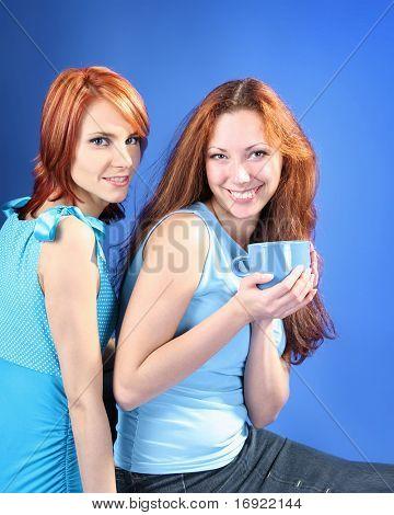 slumberous girls are drinking tea