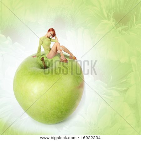 sexy redhead girl on green aple