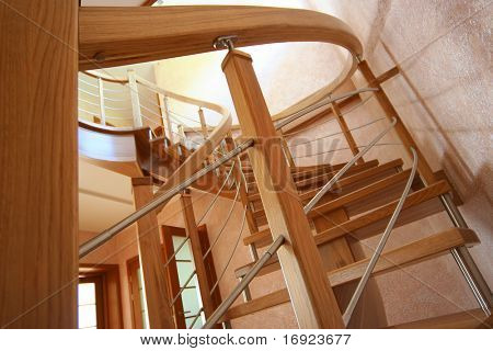 Modern wooden staircase in big house