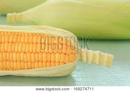 Image of fresh yellow sweet corn on table