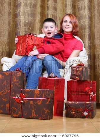 young mother with happy son are celebrating new year