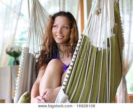 beautiful long-haired girl relaxing in hammock