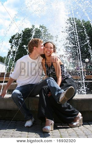 happy young couple having fun in park