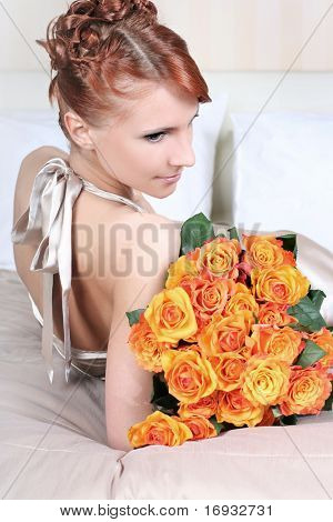 beautiful young woman with bunch of roses