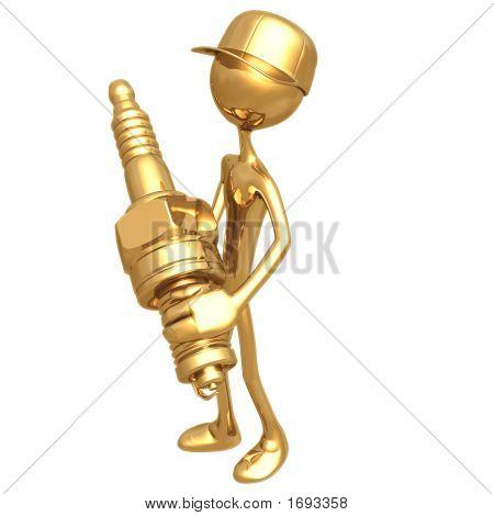 Mecánico con bujía de oro
