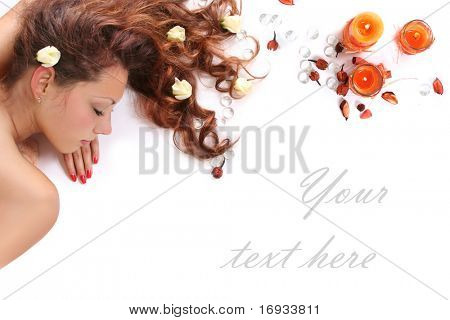 beautiful long-haired girl relaxing in spa salon