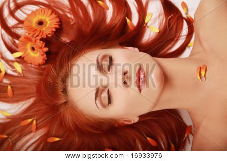 beautiful redhead girl with flowers in hair