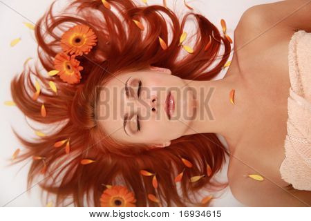 beautiful redhaired girl with flowers in hair
