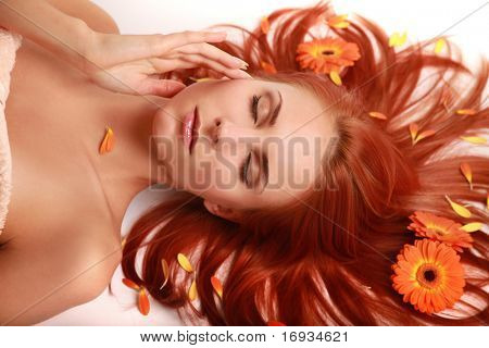 beautiful redhaired girl on white