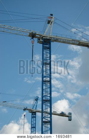 Cranes Towering Into The Sky