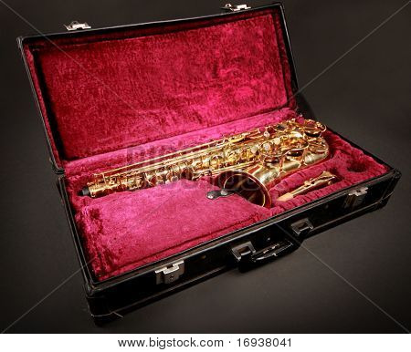 golden saxophone in black case