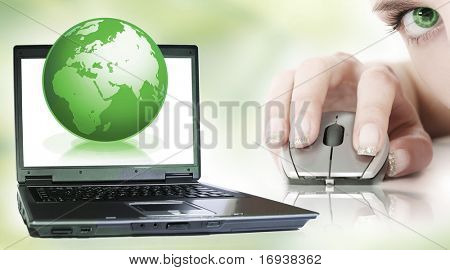 world and laptop on green