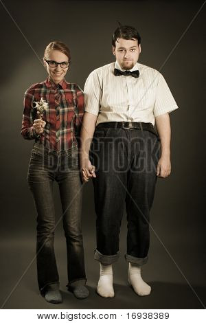 eccentric young couple on dark background