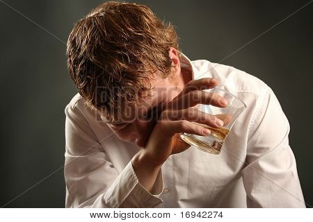 attractive young guy drinking whiskey