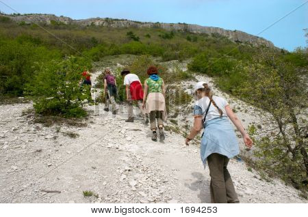 Group Of Hikers Going Up