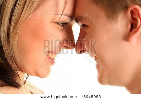 beautiful young  couple kissing isolated over white background