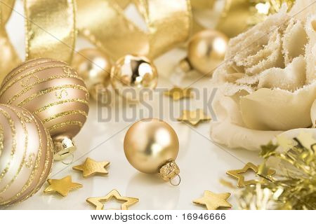 A collection of gold Christmas decorations and tree adornments. Selective focus