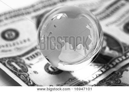 Globe and american dollars on white background.