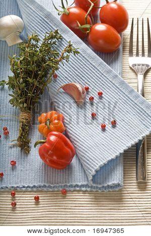 spices, vegetables and fork on blue napkin